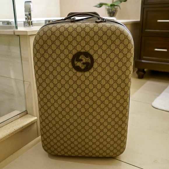 ef59c9a92964 Gucci Handbags - Gucci GG supreme beige carry-on rolling luggage